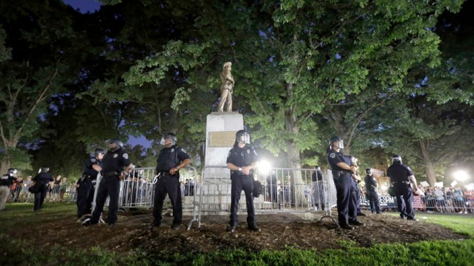 Police Surround the Confederate Monument During Protest, 22 August 2017, Photo by Gerry Broome, Associated Press.