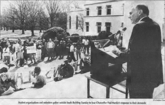 Paul Hardin delivering speech to students and housekeepers, Photo by Andrew Cline in The Daily Tar Heel, 18 March 1992, Page 1.