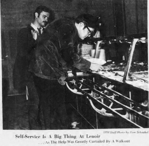 Students self-serving food in Lenoir Hall, Photo by Tom Schnabel in The Daily Tar Heel, 25 February 1969, Page 1.