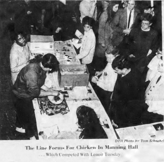 Food lines for the soul food kitchen in Manning Hall, Photo by Tom Schnabel in The Daily Tar Heel, 26 February 1969, Page 1.