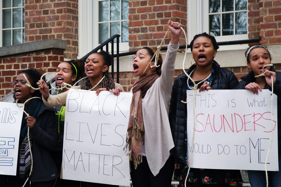 """This Is What Saunders Would Do To Me?."" Photo by Claire Collins in Lamm, Stephanie, ""Students protested history of aggression outside Saunders Hall,"" The Daily Tar Heel, 3 February 2015."
