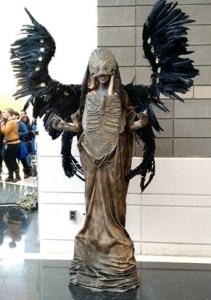 Dark angel cosplay with large, black wings