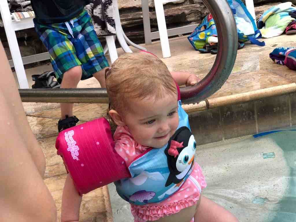Marcella's first time in a pool with a puddle jumper and she's fearless.