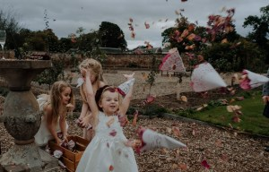 Christine McNally Photograhy 1 - Confetti flower girl playful photography