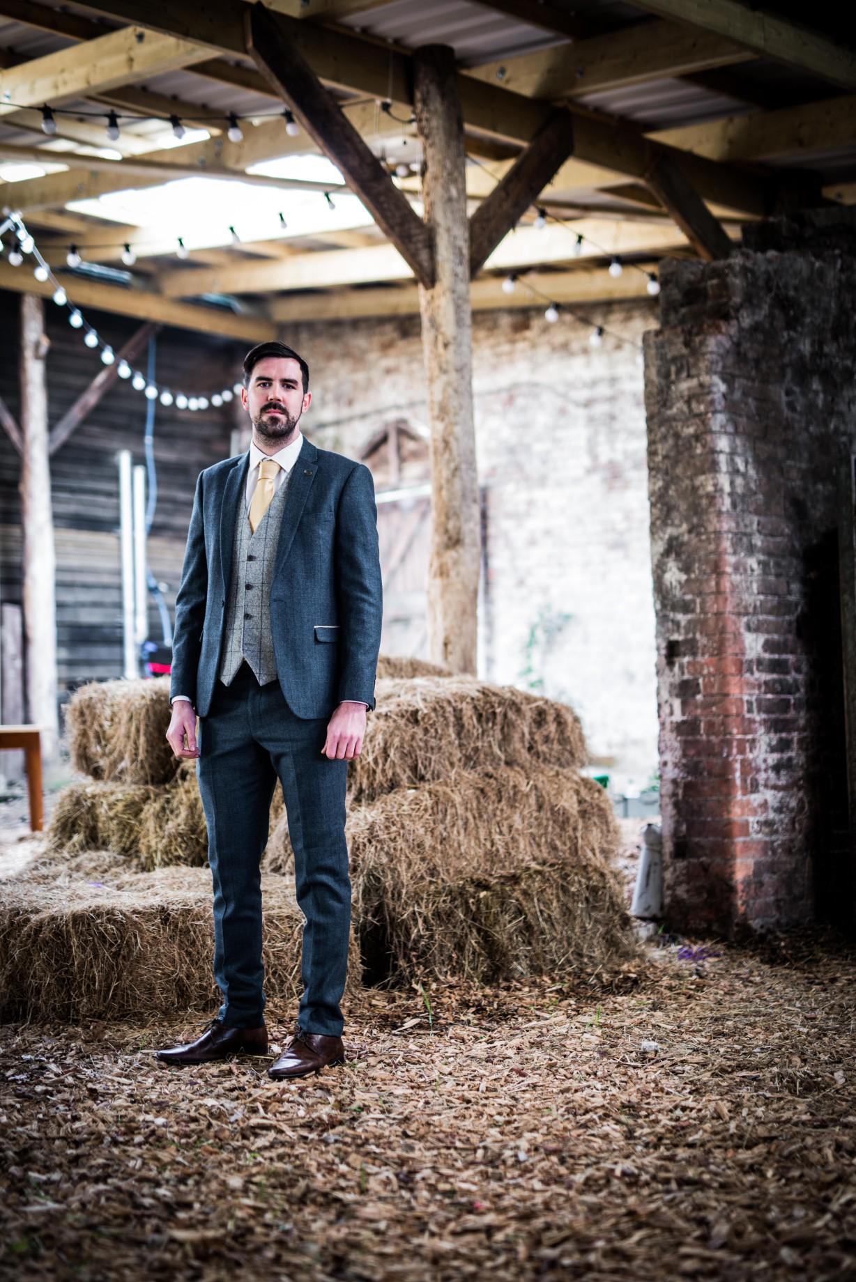 Peacock barns - alternative unconventional wedding photoshoot - rustic decadent - groom - barn