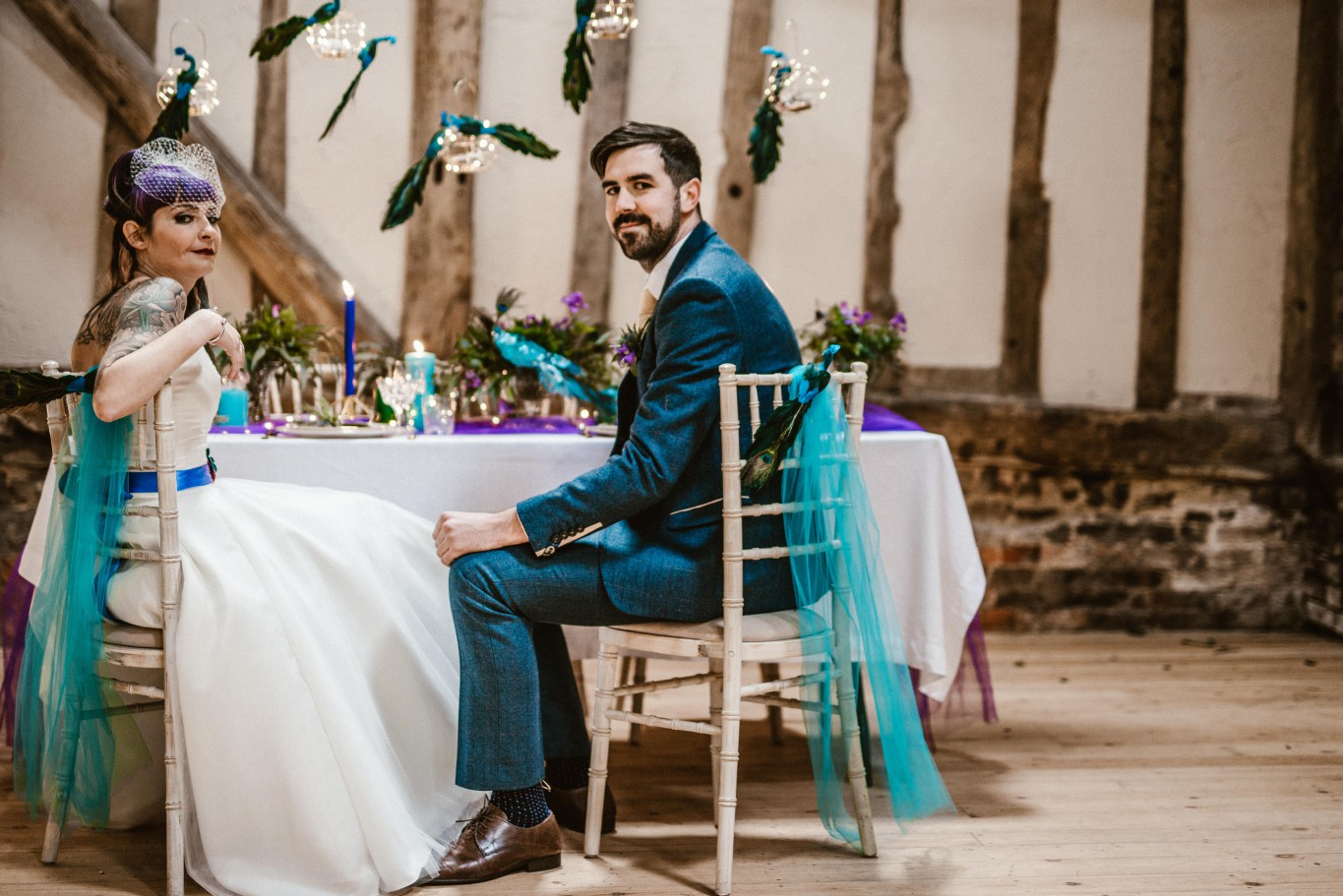 Peacock barns - alternative unconventional wedding photoshoot - rustic decadent - bride and groom at table