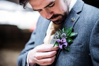 Peacock barns - alternative unconventional wedding photoshoot - rustic decadent - groom button hole