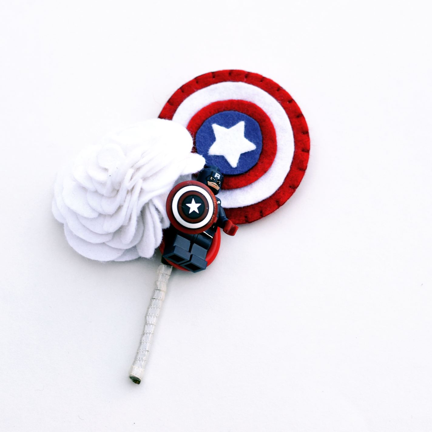 Photo by Charlotte Laurie designs - alternative wedding buttonhole - captain america button hole