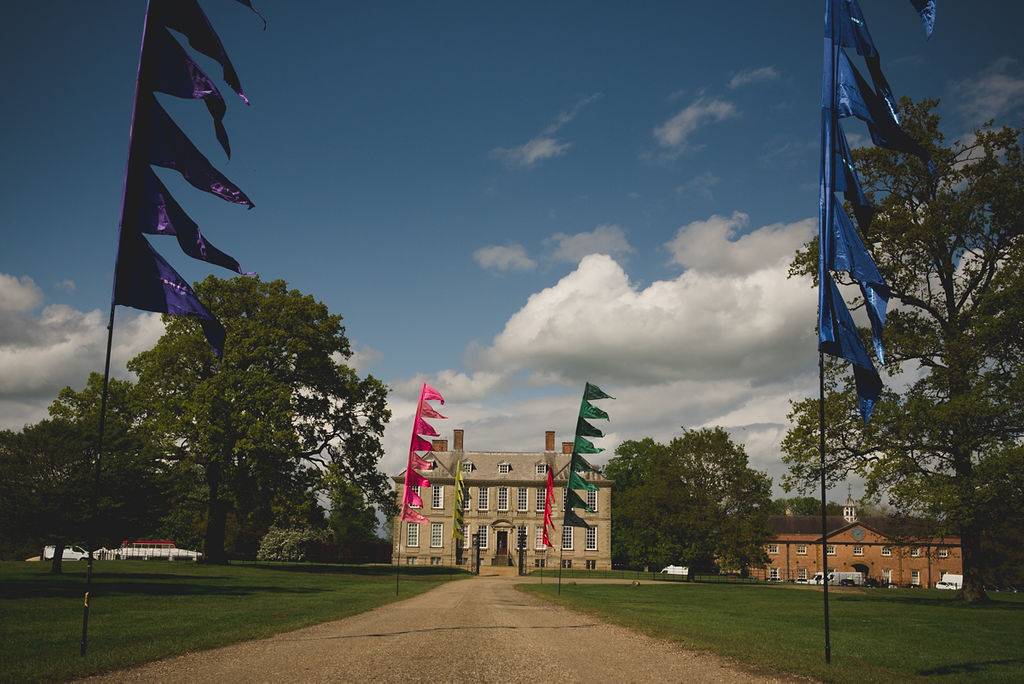 how to plan a festival wedding - the unconventional wedding festival - stanford hall weddings - event flag hire - flags