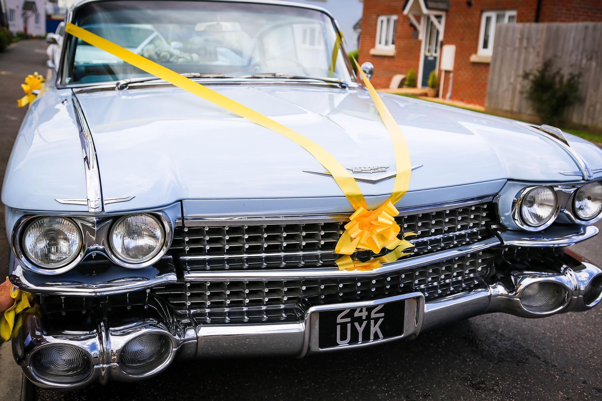 Harriet&Rhys Wedding - Magical sunflower wedding - wedding car with yellow ribbon