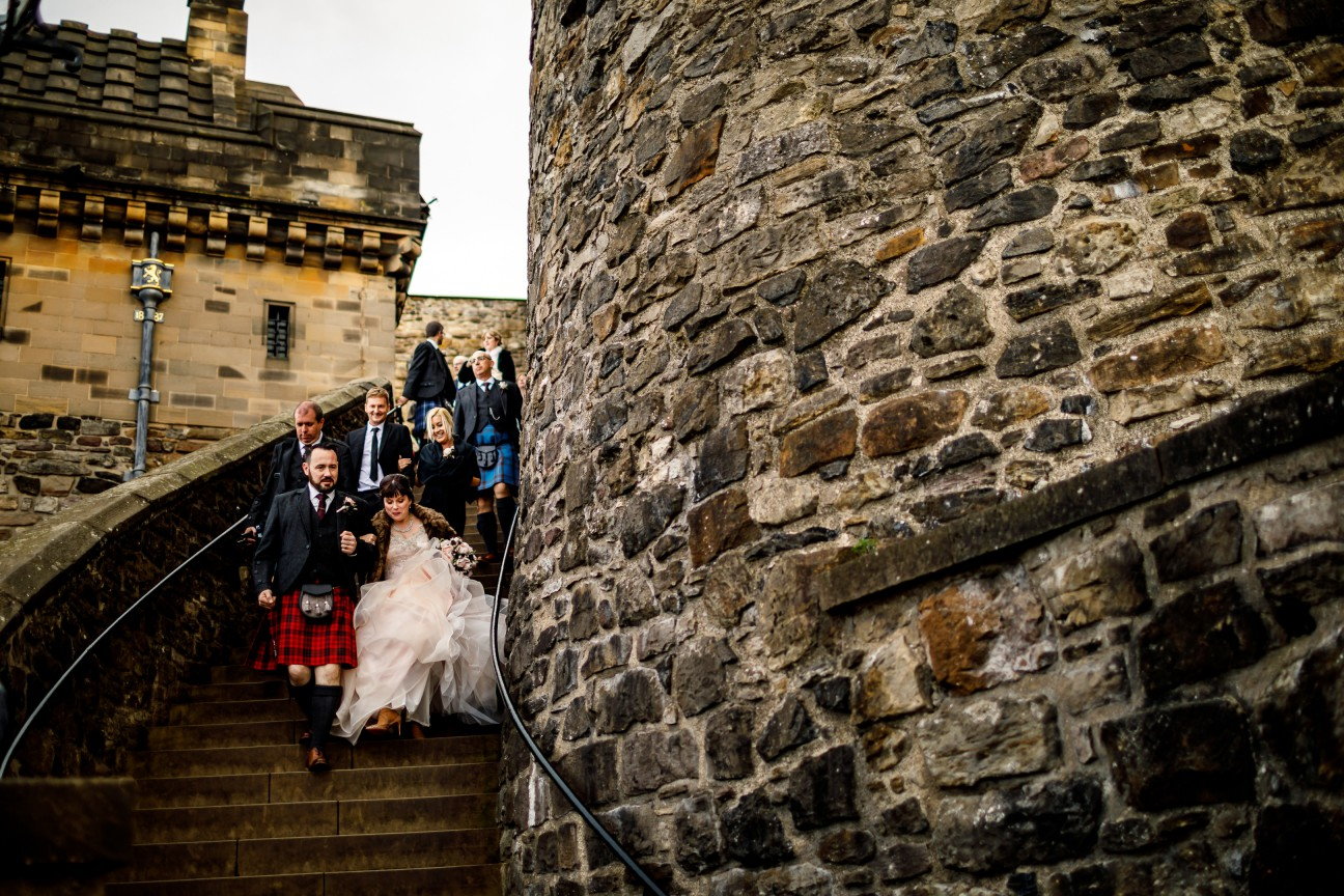 Unique Wedding Venues- Unconventional Wedding- Lina & Tom Photography- Couple leaving castle after wedding