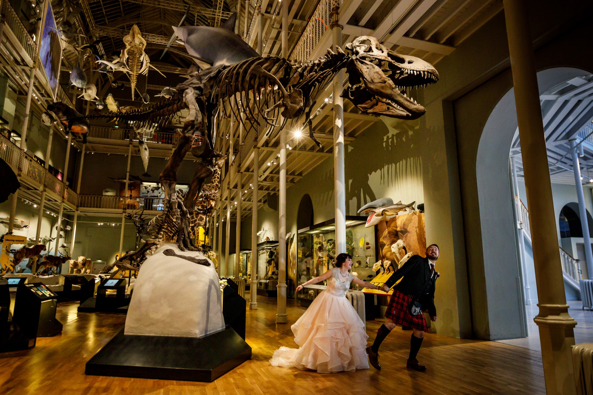 Wedding Photo in Museum by T Rex Fossil-Unique Wedding Venues- Unconventional Wedding- Lina & Tom Photography-