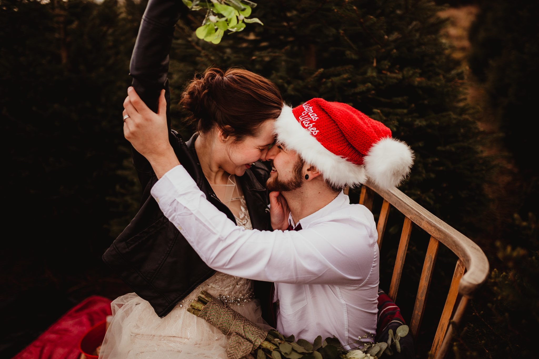 christmas elopement wedding- alternative wedding- christmas wedding- fly on the wall photography- wedding at a christmas tree farm- couple with mistletoe