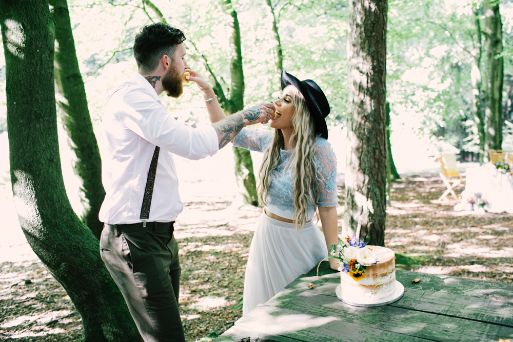bride and groom eating cake in the forest - micro-wedding - forest elopement - small weddings - alternative wedding - outdoor wedding - covid wedding