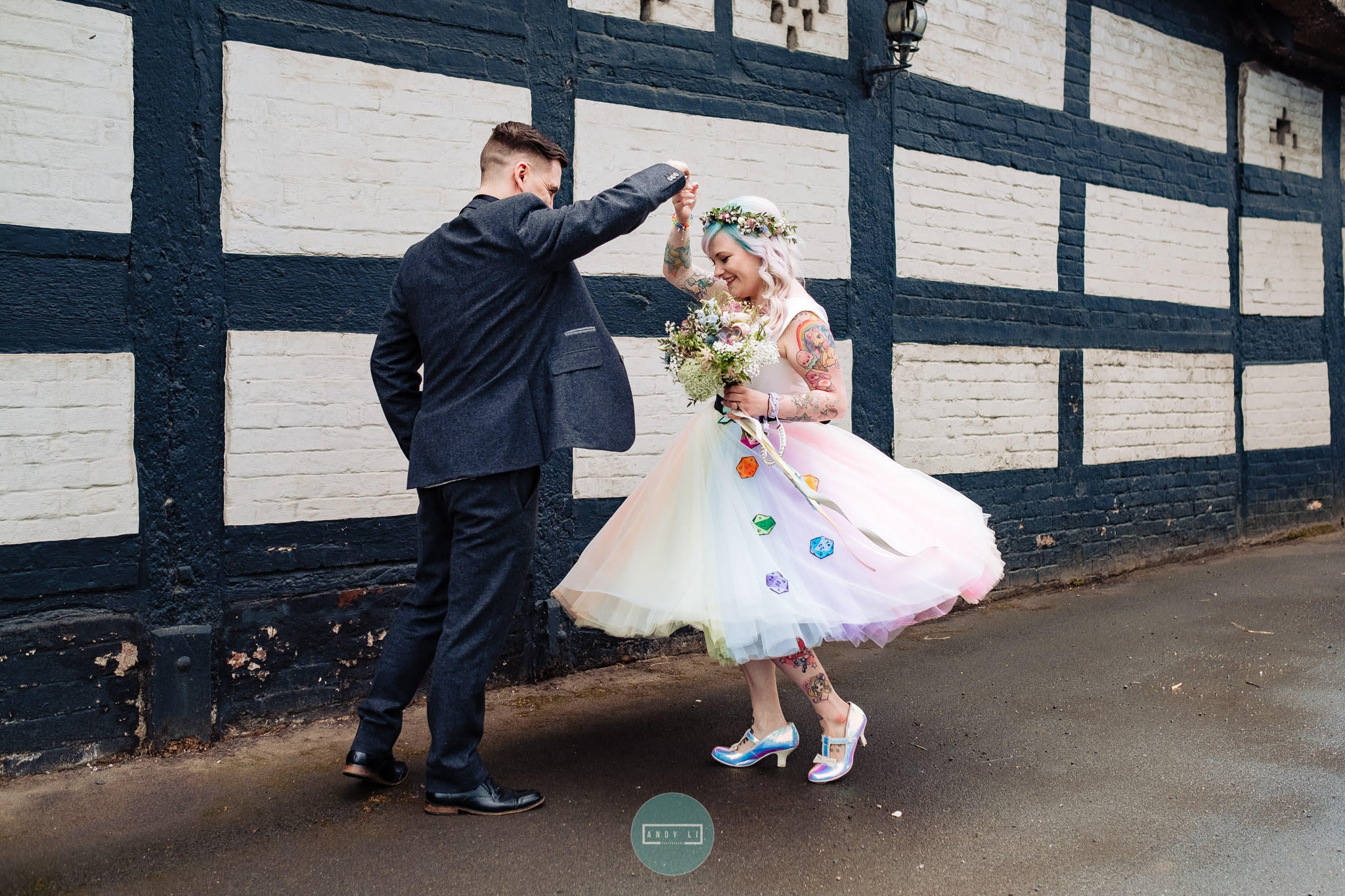 rainbow wedding dress by the little wedding shop - colourful wedding ideas with hand painted dice embellishments - dancing couple - quirky wedding dress ideas
