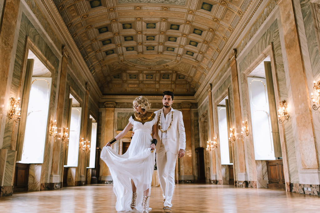 edding Inspiration- Marcella Cistola- Bride and groom walking through hall- alternative weddings
