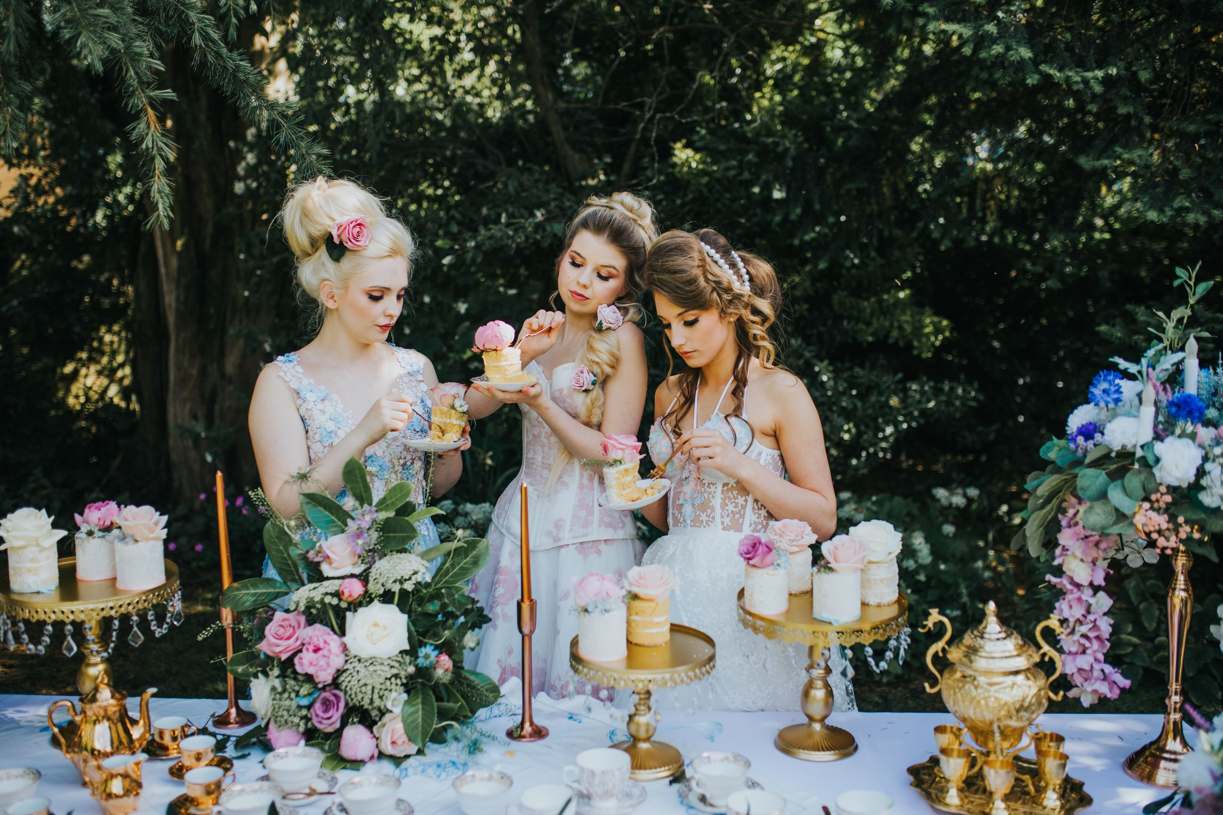 Whimsical wedding- Laura Beresford Photography- unconventional wedding- alternative wedding- brides eating cake- wedding dessert table- unique wedding cake- alternative bridalwear