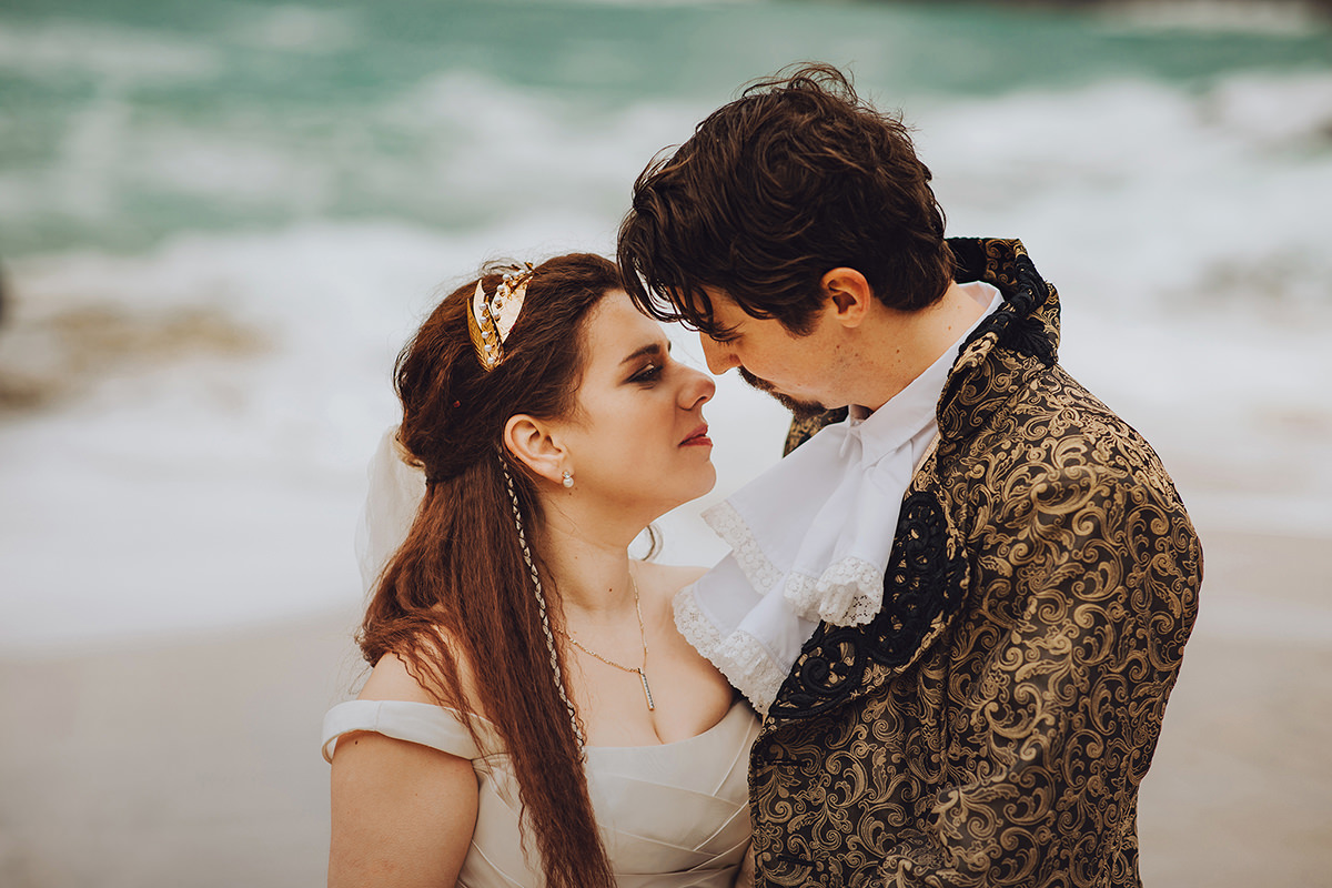 Romantic couple photo from movie themed wedding day in cornwall by the sea