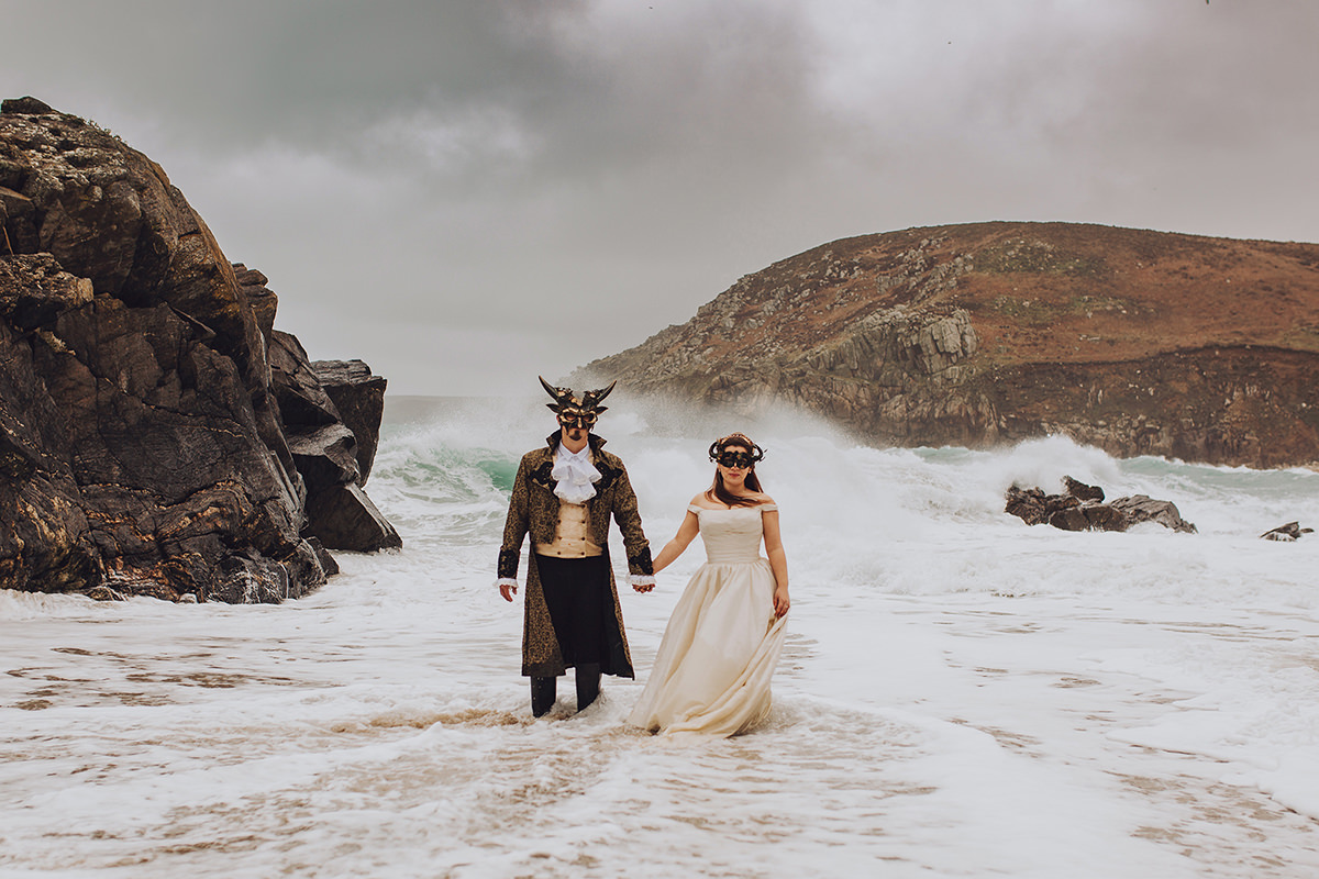 Masquerade bride and groom wedding in the sea with crashing waves - Boho Cornwall wedding venue - Honeydew Moments Photography (41)