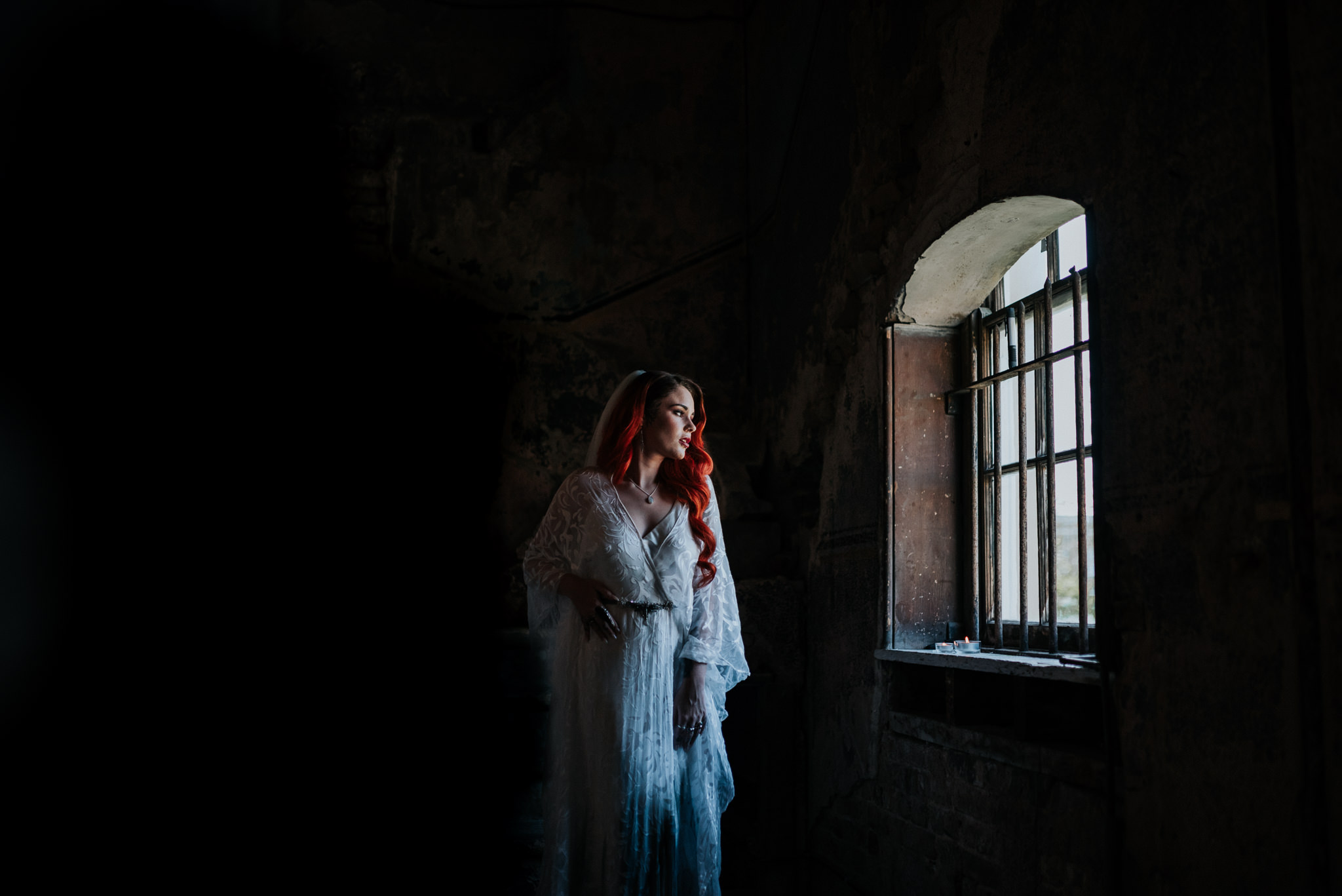 alternative chapel wedding- asylum london- unique london wedding venue- london wedding venue- Jenny Appleton Photography- bride looking out of window- gothic wedding venue