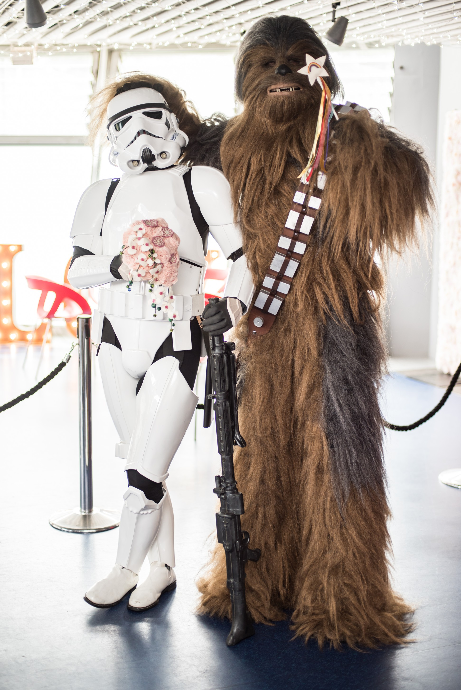 Star Wars wedding photo featuring Imperial army storm trooper holding bouquet and chewbacca holding fairy wand - by charlotte laurie designs with Imperial Icons - themed wedding ideas 2
