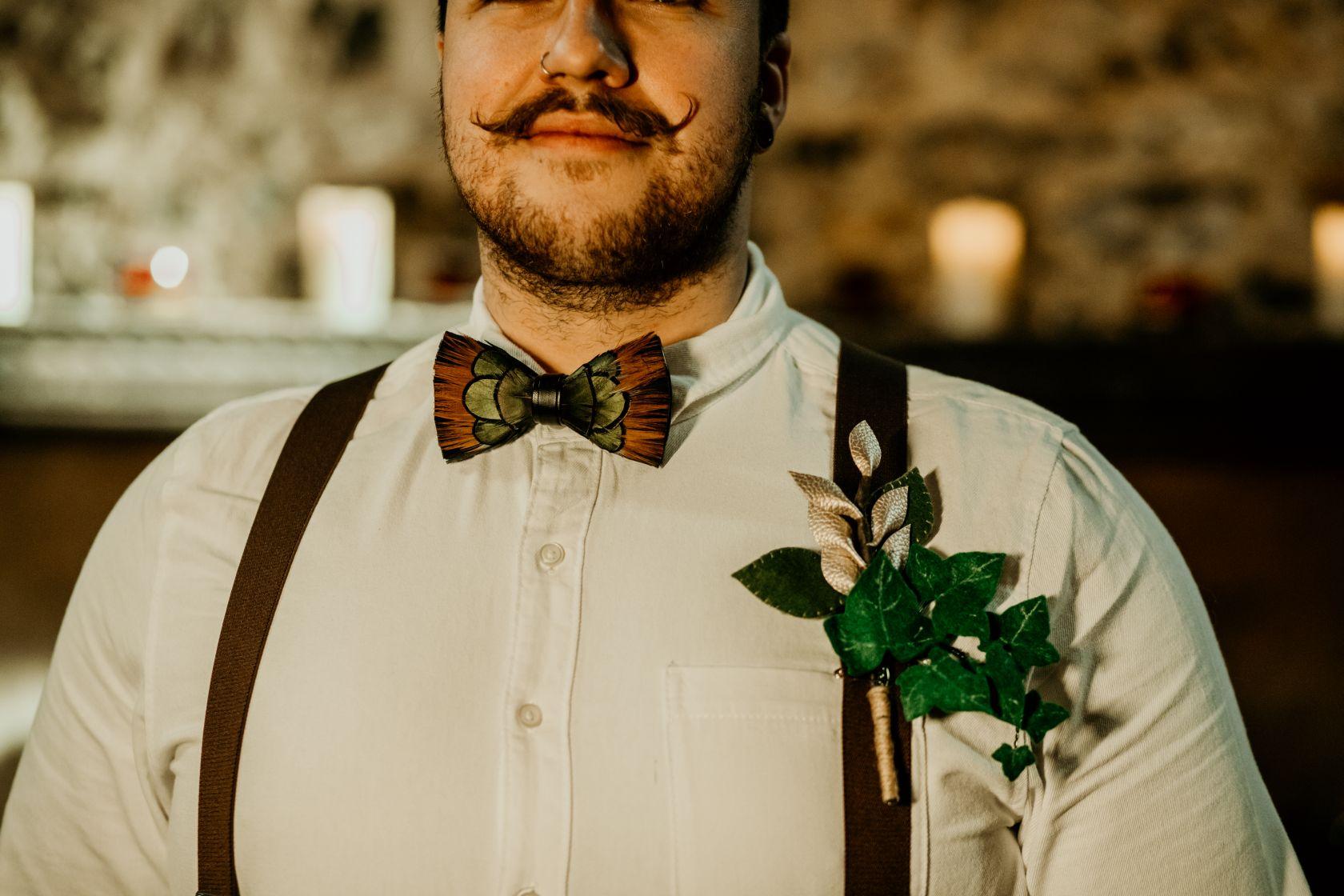 alternative fairytale wedding- snow white wedding- charlotte laurie designs-chloe mary photo- unconventional wedding- alternative wedding inspiration- feather bow tie