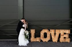 Emma DB Photography - Northampton wedding photographer - modern elegance - wooden love letters with couple