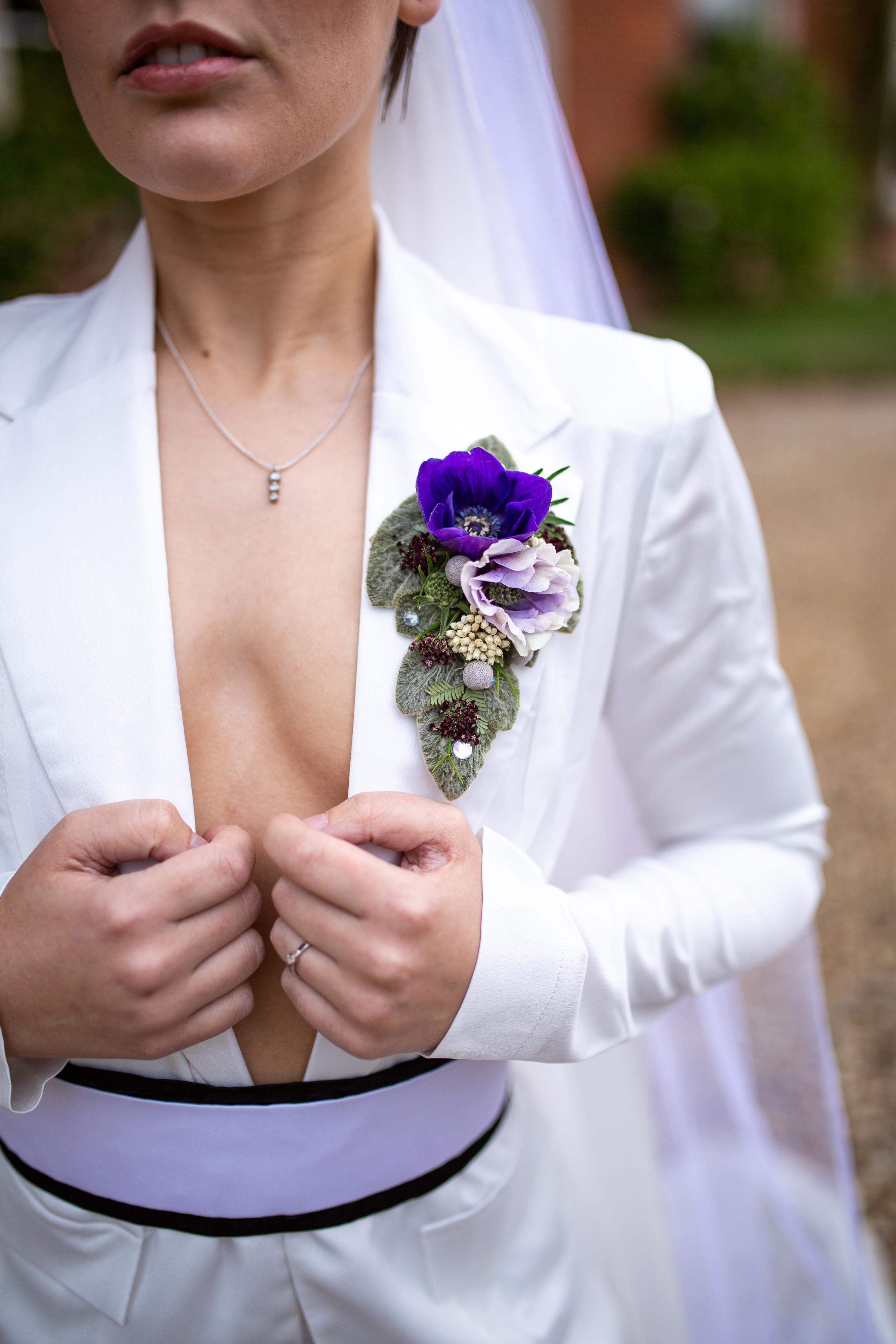 iconic wedding looks- music themed wedding- unconventional wedding- alternative wedding- womens white suit- alternative button hole- annie lennox style- womens wedding suit