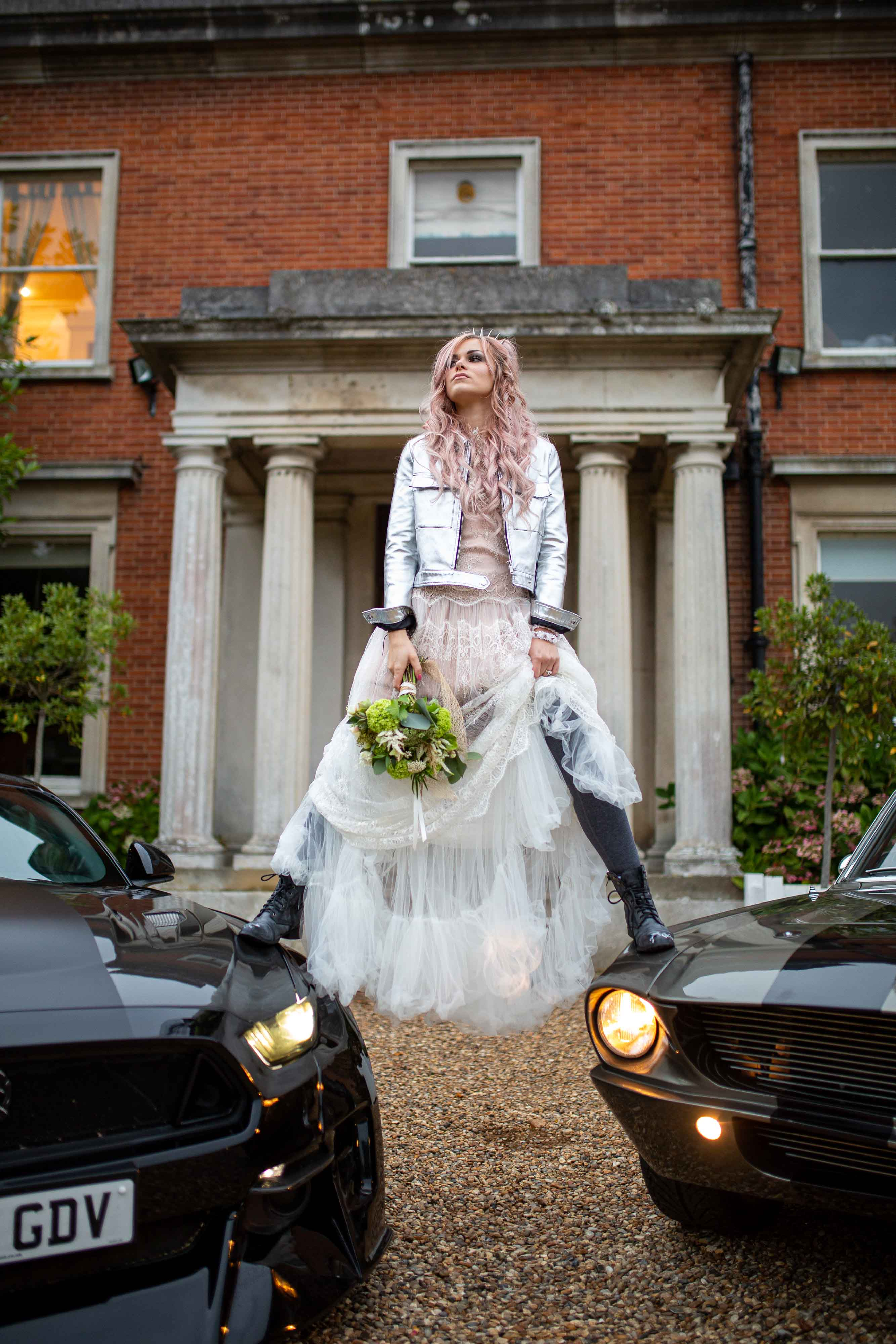 music themed wedding - unique wedding looks inspired by music icons - edgy wedding - rock and roll wedding - grunge wedding - courtney love style- bride standing on cars