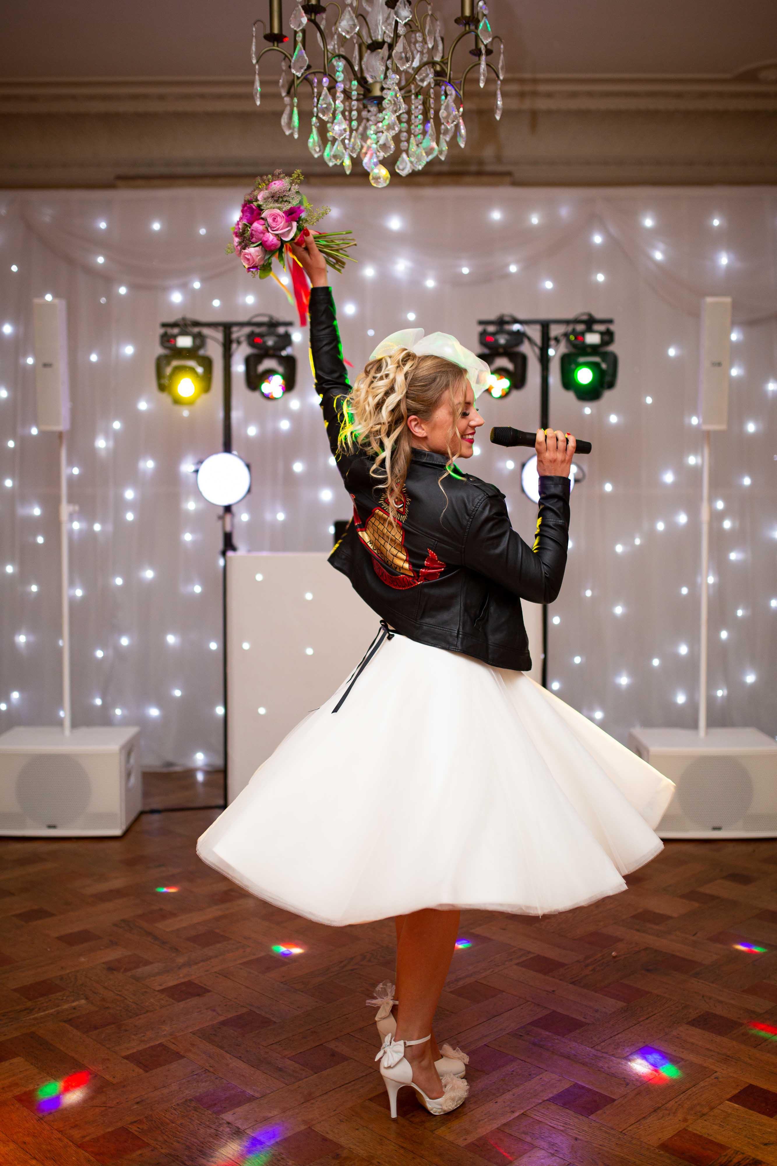 iconic wedding looks- music themed wedding- unconventional wedding- alternative wedding- music lovers wedding- retro weding dress- madonna wedding dress