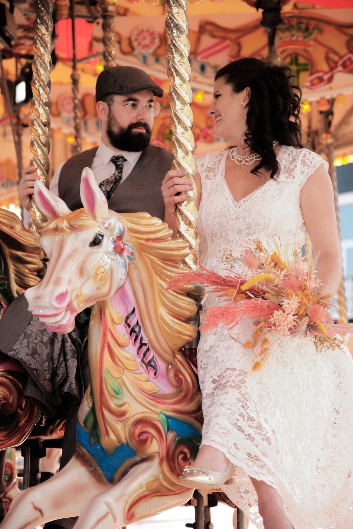 city elopement- cardiff bay wedding- wales elopement- urban elopement - cardiff wedding - colourful summer wedding- wedding photos on carousel
