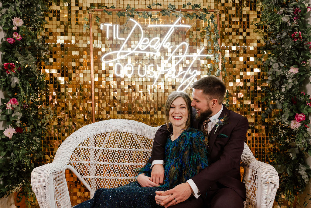 peacock themed wedding - peacock wedding - unique wedding colour scheme - quirky wedding - luxurious wedding - neon wedding sign - til death do us party - sparkly wedding backdrop- peacock wedding dress- alternative bridalwear- unique wedding dress