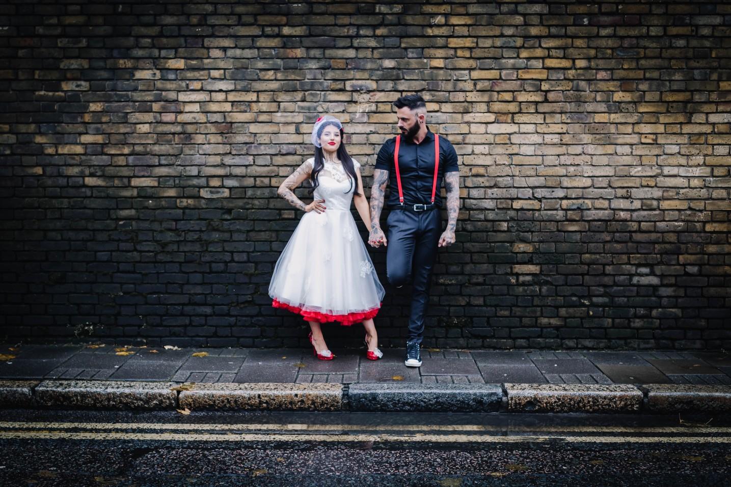 alternative couple- rockabilly bride - retro wedding dress with red underskirt