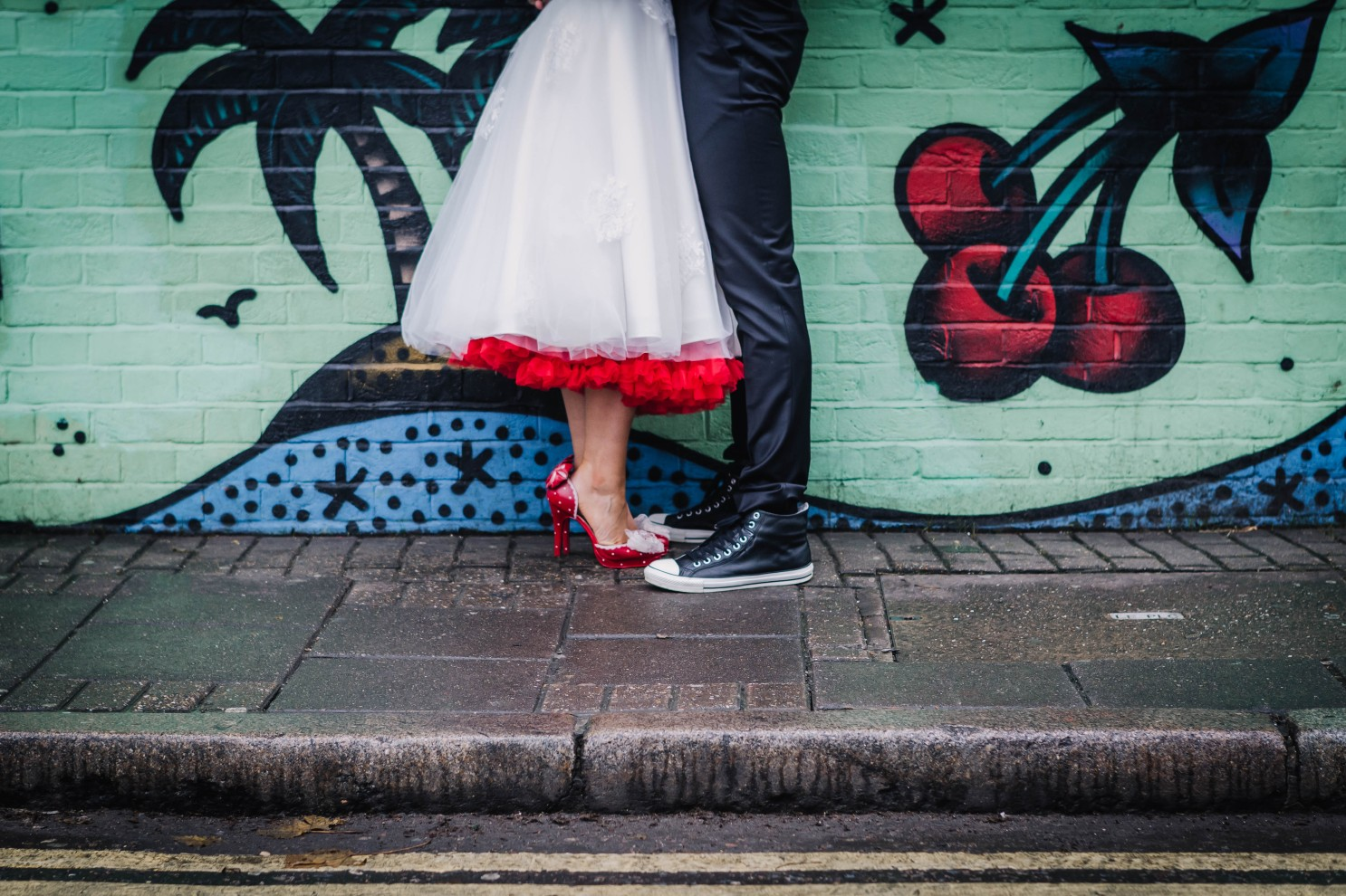 red high heels - retro wedding shoes - converse wedding shoes against an urban wedding backdrop