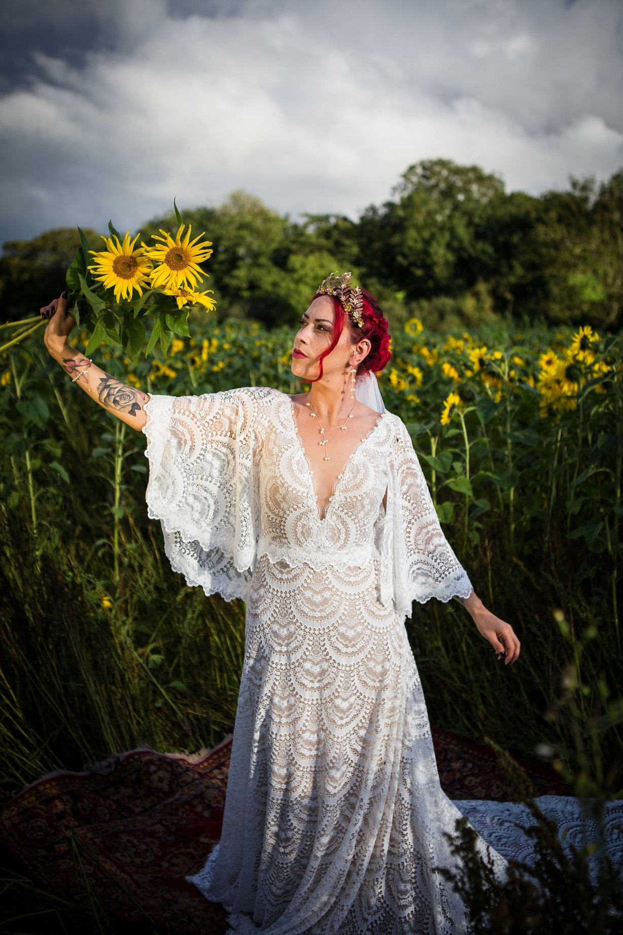 sunflower themed wedding - unconventional wedding - sunflower wedding - autumn wedding - alternative wedding planning - bride in field with sunflowers