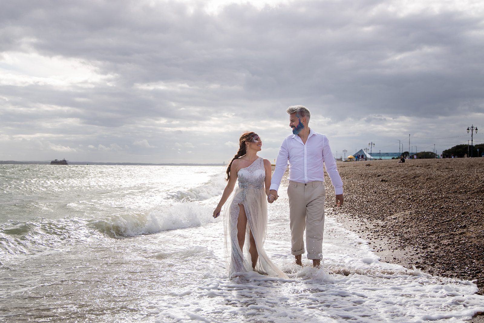 mermaid wedding - beach wedding - quirky wedding - unique wedding - alternative seaside wedding - alternative wedding - bride and groom walking on the beach