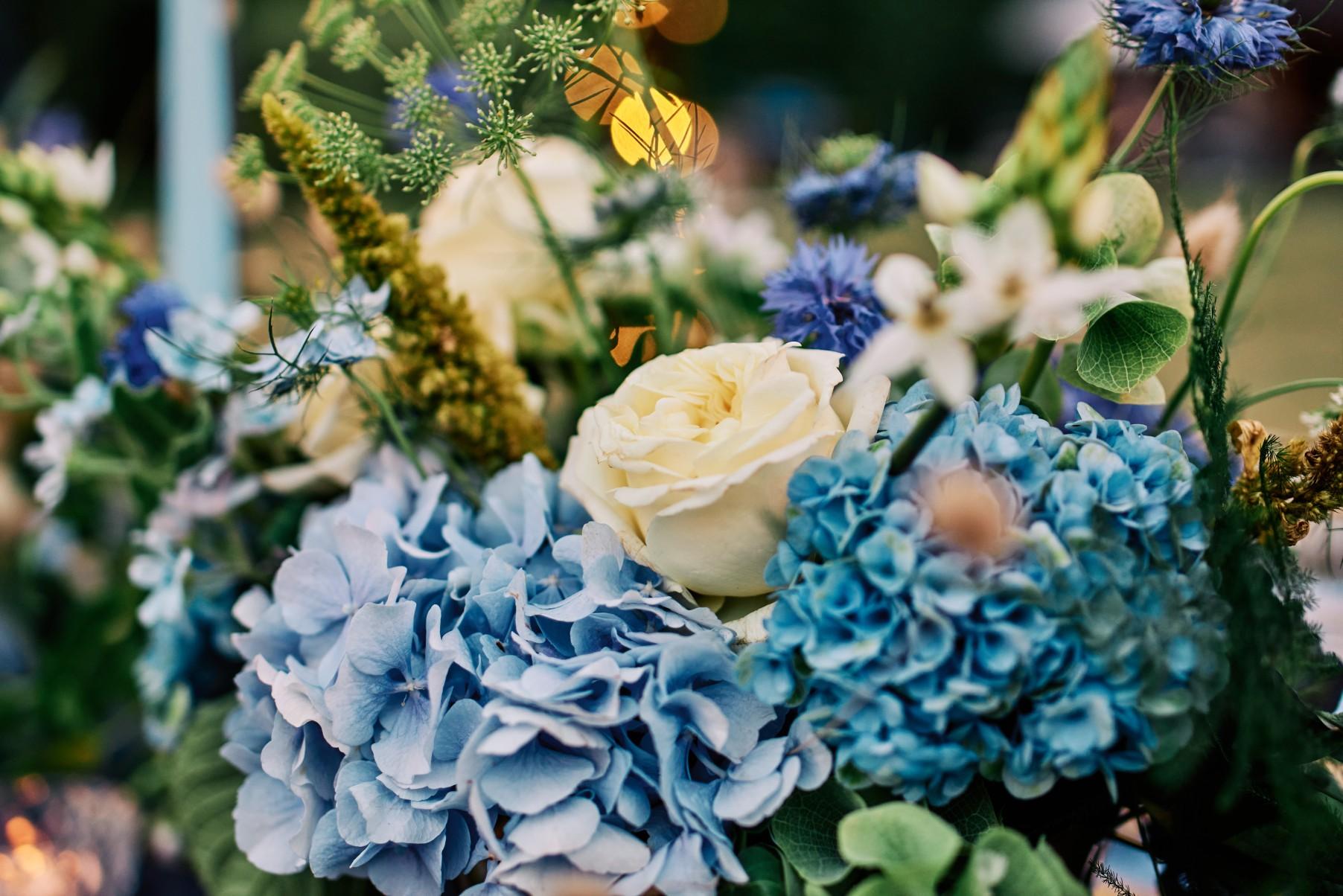 nhs wedding - paramedic wedding - blue and gold wedding - outdoor wedding - micro wedding - surprise wedding - blue and white wedding flowers