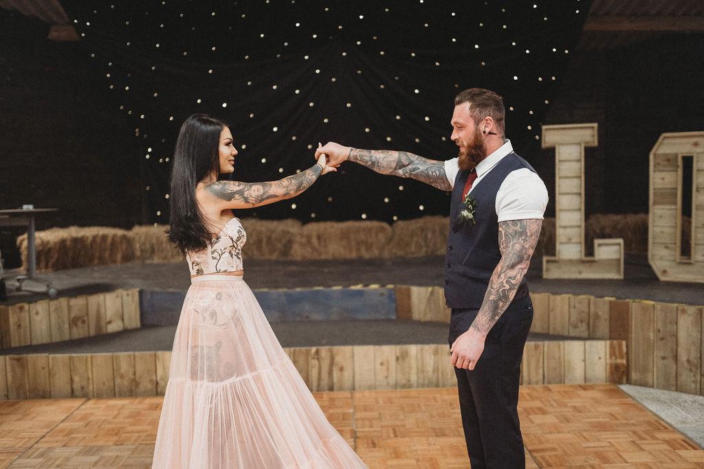 bride and groom dancing - alternative farm wedding, edgy wedding, tattooed wedding, alternative wedding