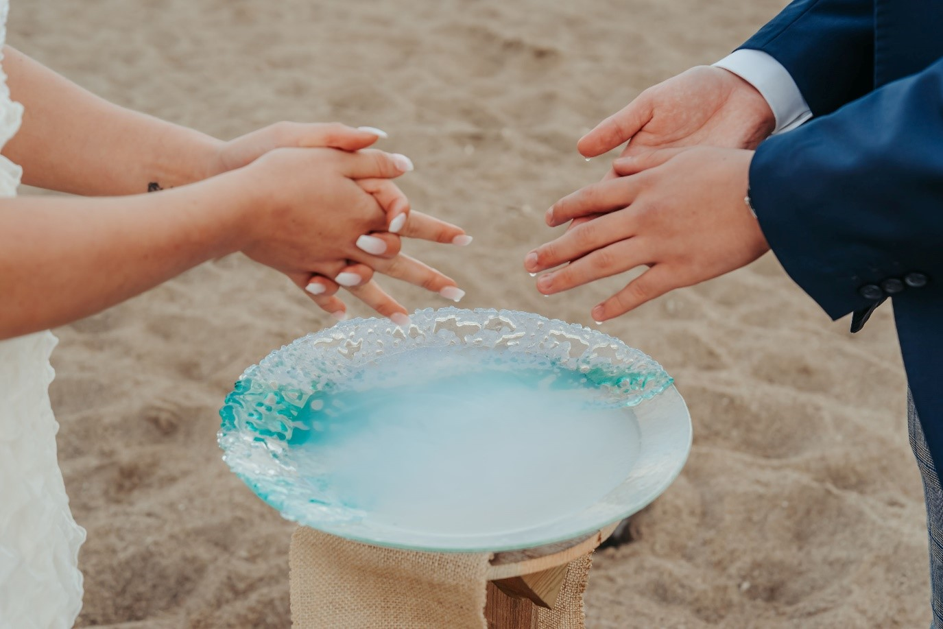 beach elopement - beach wedding - eco friendly wedding -tempest themed wedding - celebrant hand washing ceremony