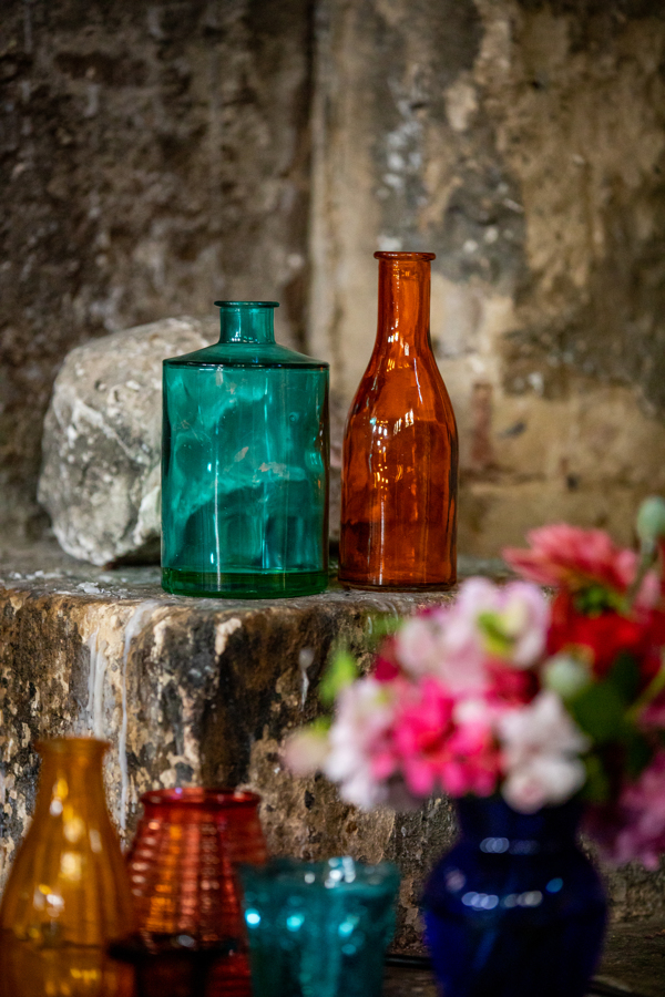 colourful alternative wedding - eclectic glass vases - eclectic wedding styling - unique wedding crockery