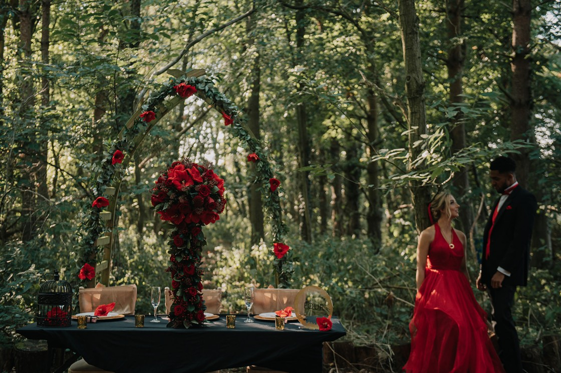 small wedding - forest elopement - red wedding dress - red wedding flowers