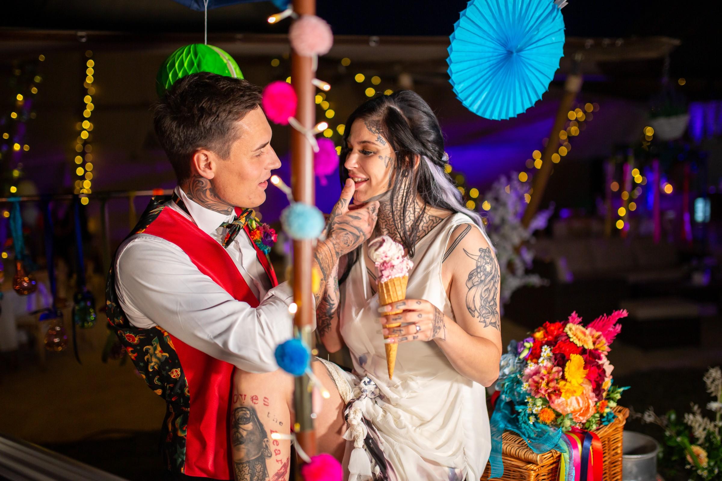 rainbow festival wedding - colourful wedding - quirky wedding ideas - bride and groom eating ice cream
