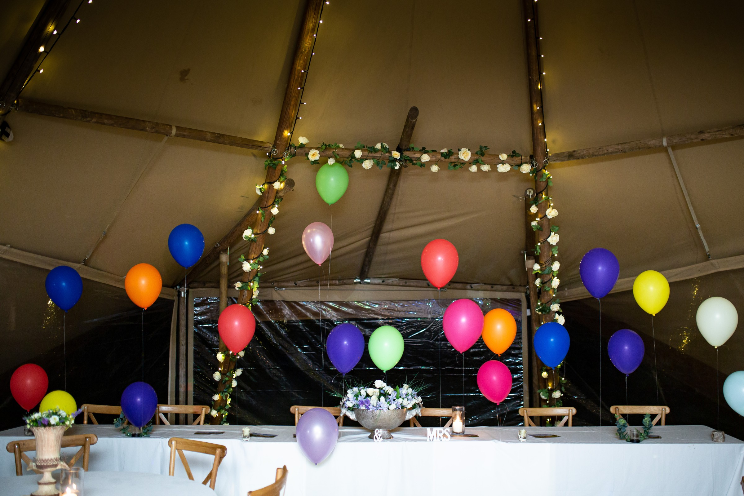 colourful balloons in a marquee for a rainbow festival wedding