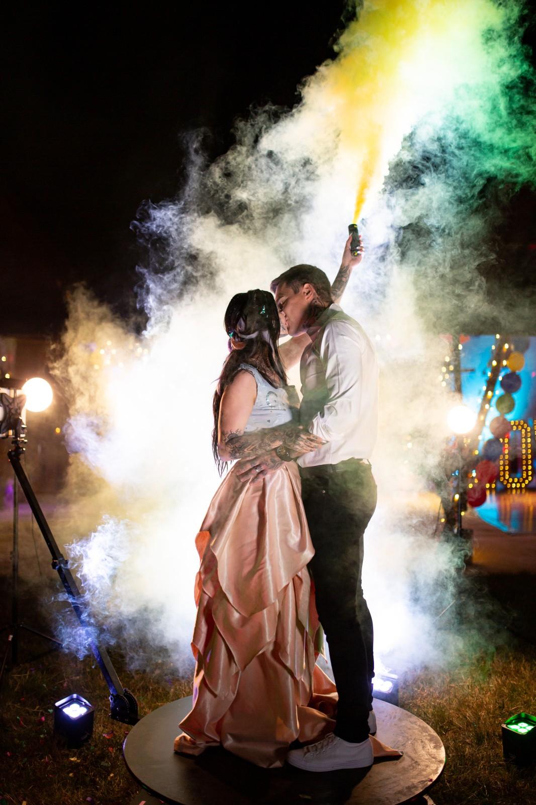 rainbow festival wedding -fun wedding photos - bride and groom with smoke bomb