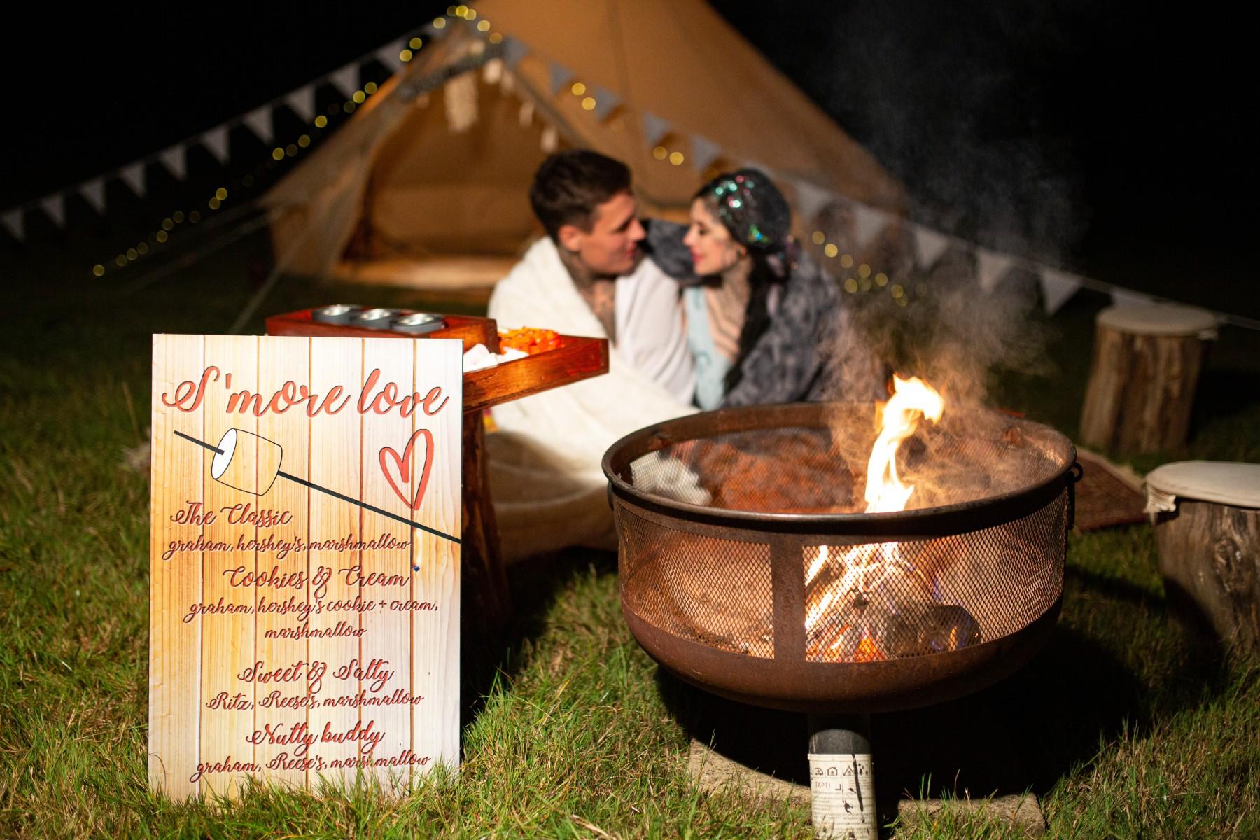 festiva weddingl - bride and groom by campfire with smores