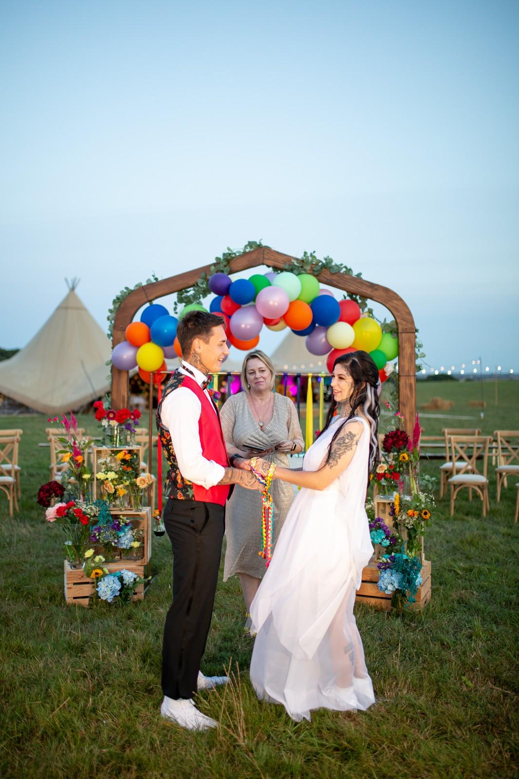 rainbow festival wedding - colourful wedding - quirky wedding ideas - festival wedding ceremony - handfasting ceremony