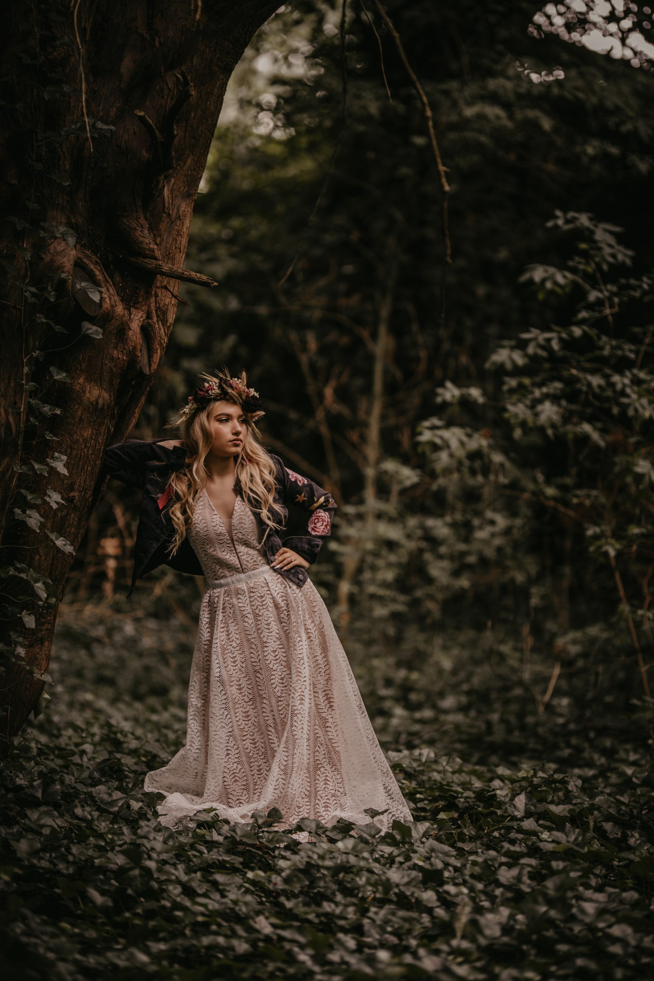 fairytale boho wedding - alternative forest wedding - bride leaning against a tree