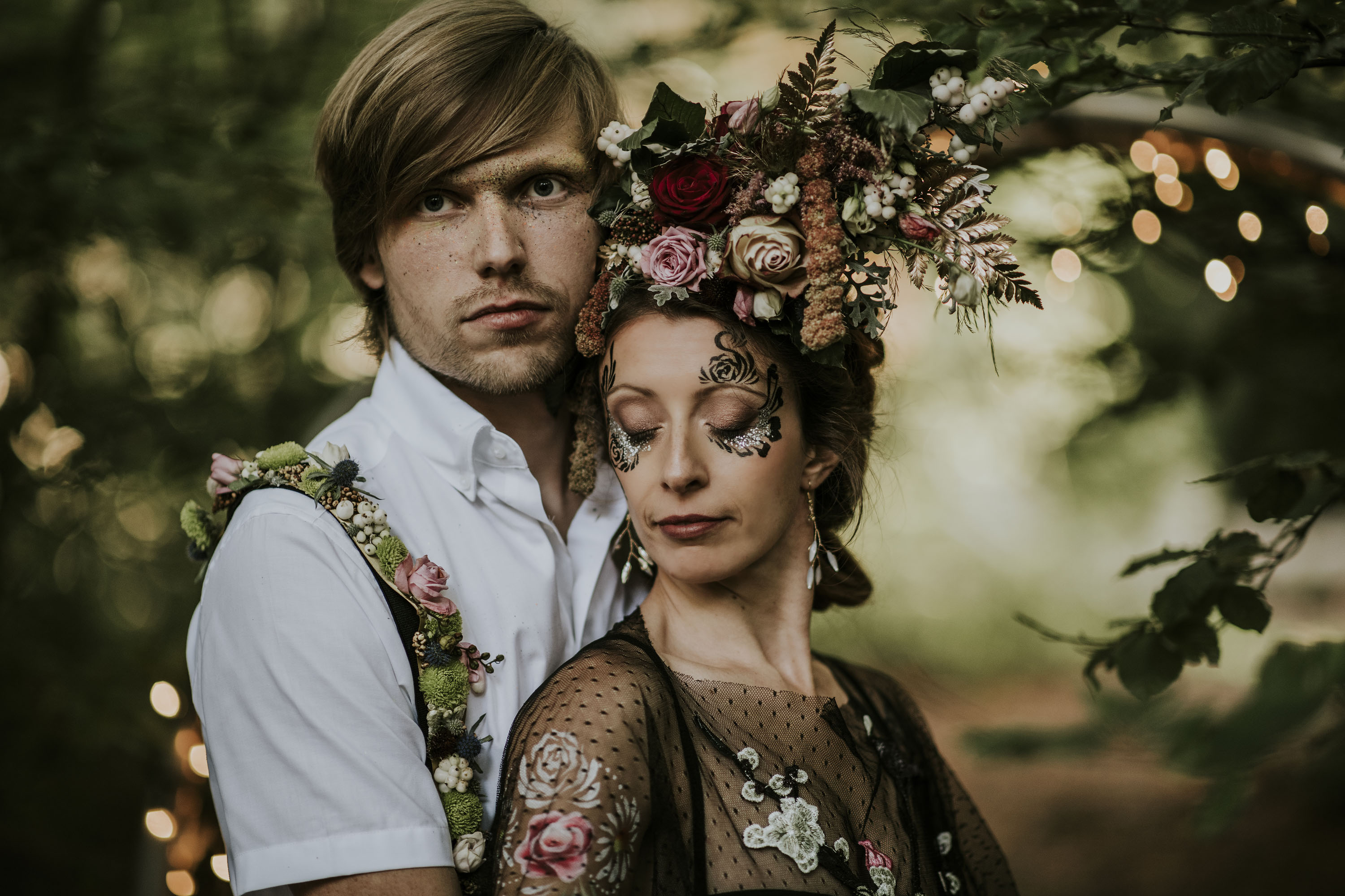 alternative bridal wear, black wedding dress, floral headdress and bridal body paint - groom's floral suspenders