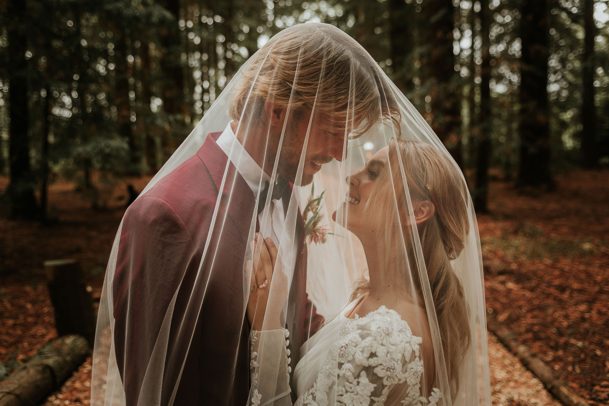 modern woodland wedding - romantic wedding photography - bride and groom under veil