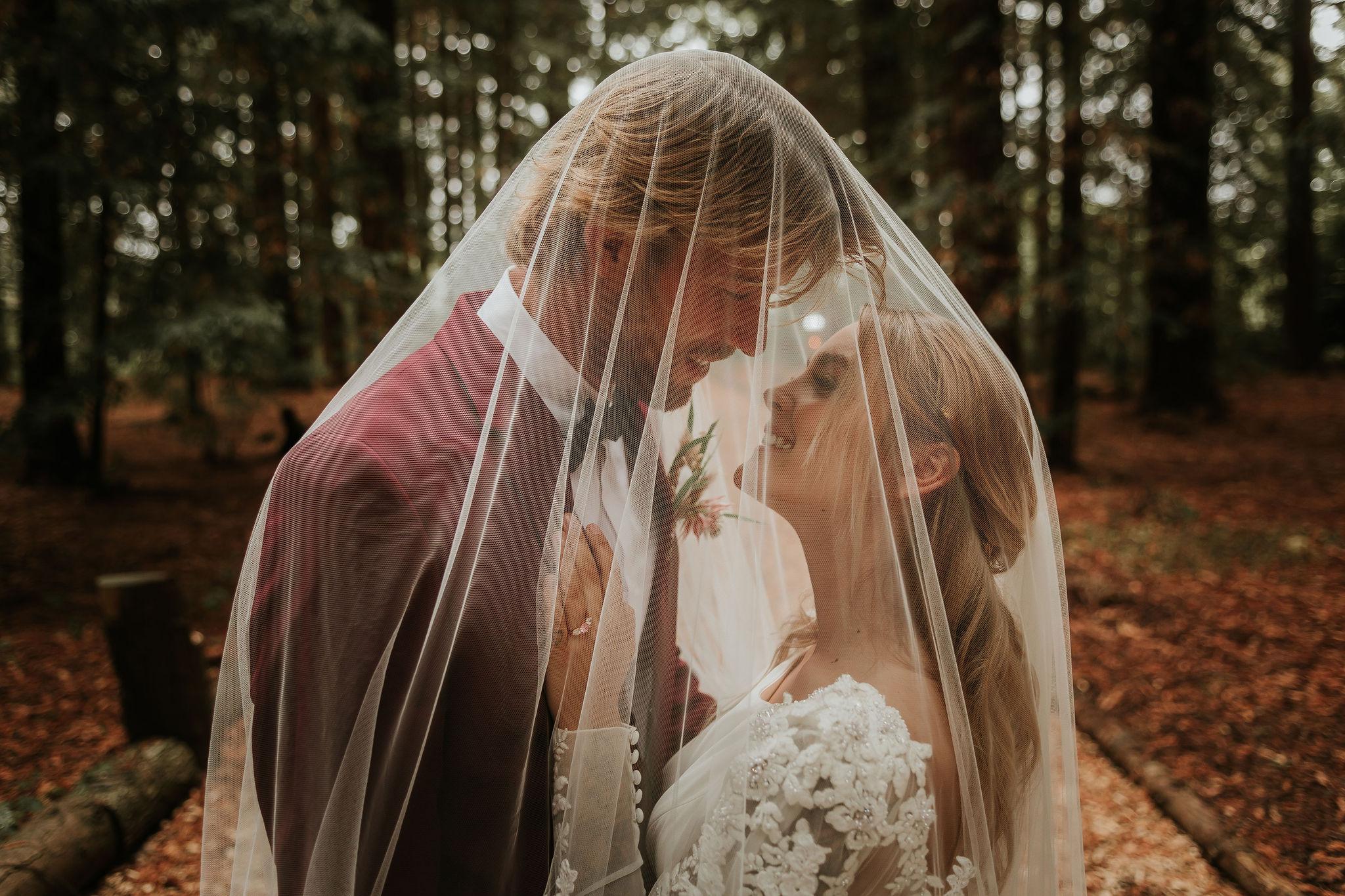modern woodland wedding - romantic wedding photography - bride and groom under veil